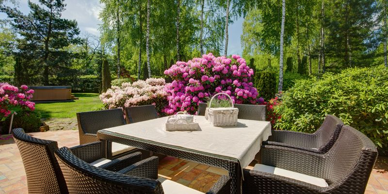 patio furniture in beautiful backyard